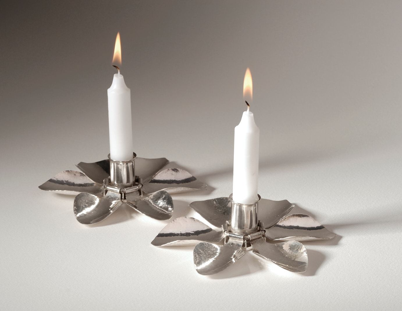 FLOWER CANDLESTICKS